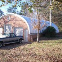 S Model Multi Level Garage With Brick Quonset Hut